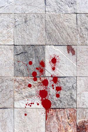 Red blood splatter on stone wall Stockfoto