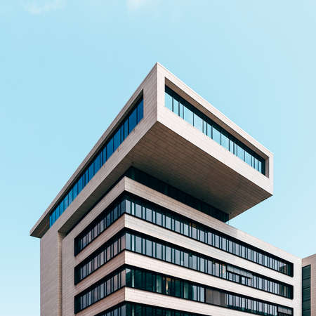 Minimalist office building against sky in Hamburg
