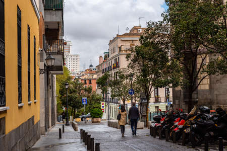 Street scene in historic centre of Madrid a rainy day during Easter week Editorial