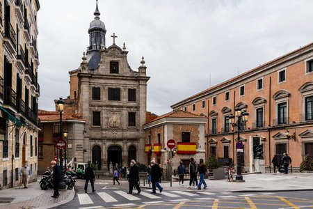 People crossing Mayor Street in front of Military Cathedral of Spain in Madrid