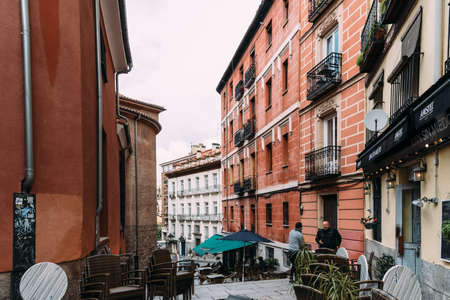 Cosy Narrow Street with Terraces of Cafes and Restaurants in Central Madrid