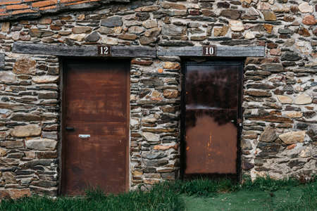 Iron doors in traditional slate stone houses in mountain village