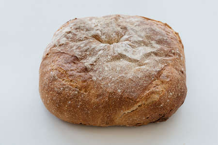 Freshly baked traditional bread on white table