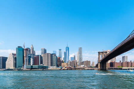 Manhattan Bridge and cityscape of NYC from East River