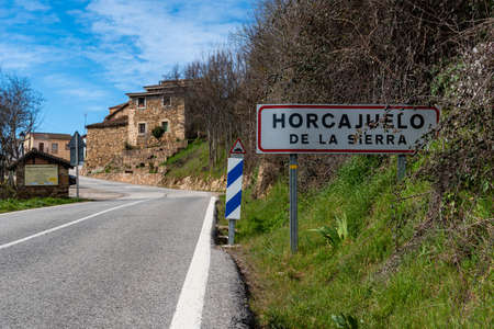 Entrance road to the village of Horcajuelo de la Sierra during springtime Editorial