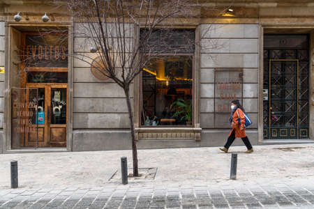 Woman Walking By Empty Tapas Bar in Historic Centre of Madrid Editorial