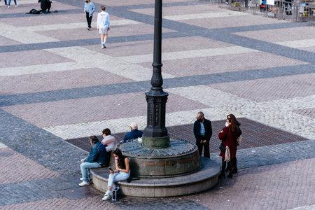 People enjoying sitting or walking in Plaza Mayor Square in Madrid