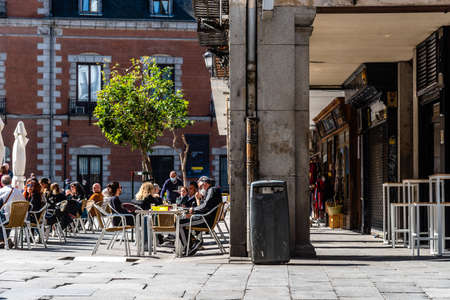 People enjoying on the terrace of a bar in Central Madrid during the covid-19 coronavirus pandemic