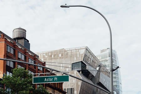 Cityscape of New York at Astor Place with Cooper Square building on background Editorial