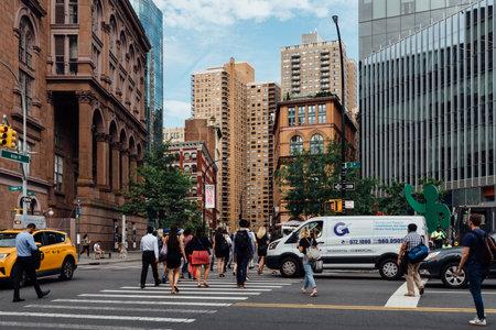 People crossing street in East Village in New York Editorial