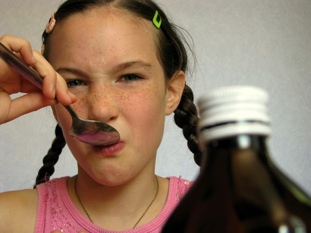 taking medicine: Child taking foul-tasting medicine