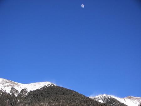 ponderosa pine winter: moon over snowy san francisco peaks - flagstaff, az