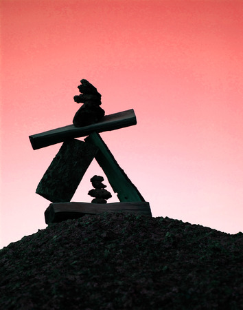 cairn: zen cairn - rocklog art and colorful sky Stock Photo