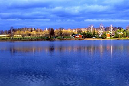 Hunting and fishing base, located in a picturesque place, on the shore of a reservoir. Autumn evening
