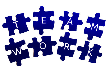 Business Concept  Teamwork is spelt out as individual pieces in a jigsaw, emphasising that each person has a part to play in the complete picture Banco de Imagens