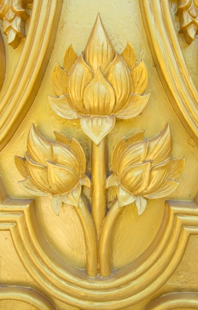 lotus carved gold paint on temple door  photo