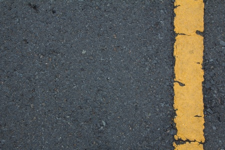 Asphalt road texture with right yellow stripe photo
