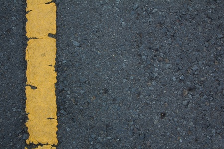 Asphalt road texture with left yellow stripe  photo
