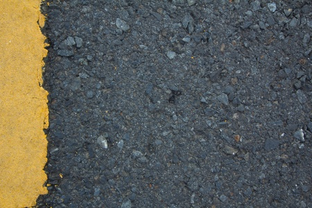 Road texture with left yellow stripe  photo