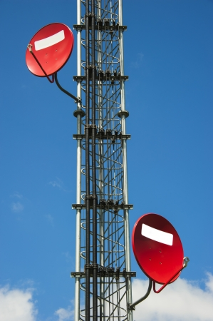 stanchion: two red satellite dish at stanchion