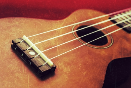 grunge image of ukulele on a vintage background photo
