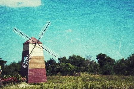 windmill and old house barn on grunge paper background photo