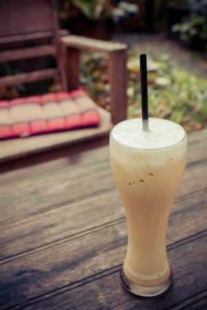 Iced coffee in the cafe garden photo