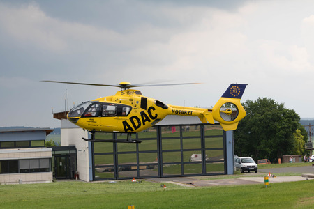 arrives: Jena Schöngleina Airport - Germany - June 04, 2016 - ADAC Air Rescue Helicopter arrives at his base