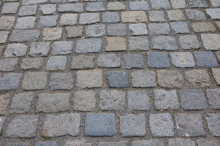 cobblestone road: granite cobblestone road pavement Stock Photo