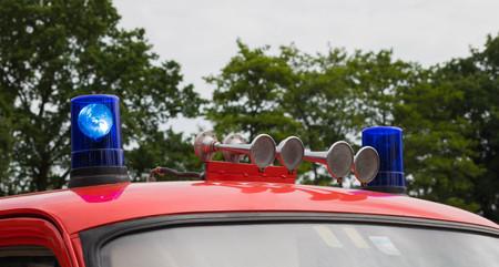 antique fire truck: flashing blue lights and horn on a German firetruck Stock Photo