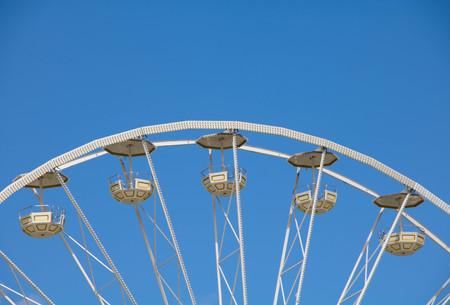 Ferris Wheel in front of blue sky