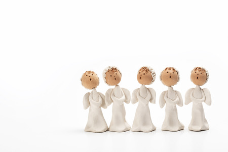 Group of Christmas carolers angel figurines