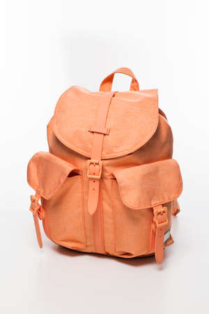 Salmon pink women fashion backpack on white background