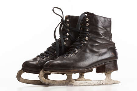 Pair of old vintage ice skates on white background