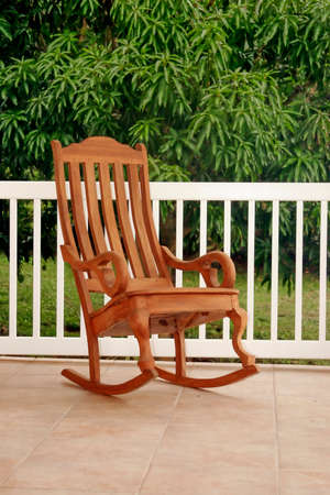 Exceptionnel Gorgeous Simple Wooden Rocking Chair On Porch. Brown, Green, White And Tan  Colors