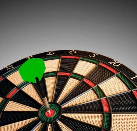 visually: Dart hits dead center of dart board. Visually radiates. Room for text at the top. Stock Photo