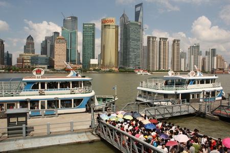 Shanghai, China, 5 August 2010 - Skyline of Shanghai and tourist boats Stock Photo - 8666428