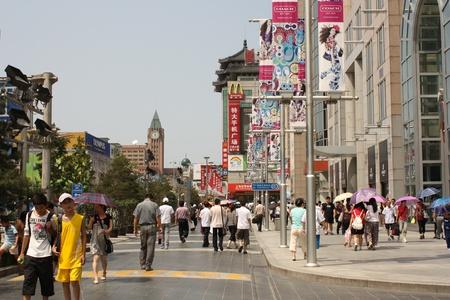 Wangfujing street in Beijing, China, August 10, 2010 - People are walking in the Famous Wangfujing shopping street in Beijing