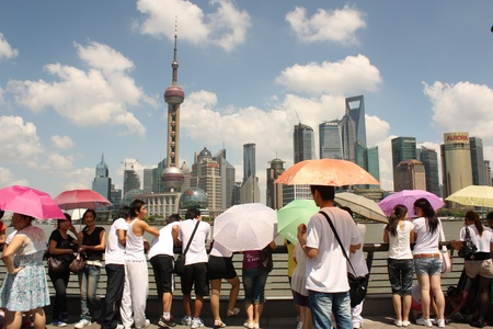 pudong: Pudong district of Shanghai, China August 5, 2010 - Shanghai skyline with tourists