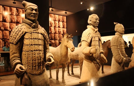 manlike: China, Xian, July 24, 2010 - Terracotta Warriors and Horses in a Museum of History Editorial