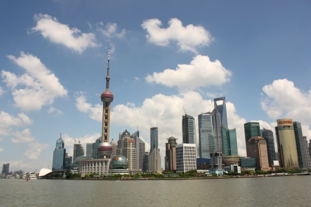 shanghai pudong skyline: Pudong district of Shanghai, China August 5, 2010 - Skyline of Shanghai with Oriental Pearl TV Tower Editorial