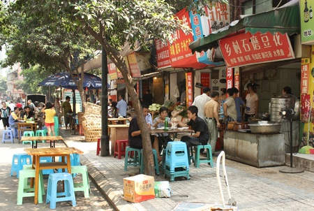 outdoor cafe: Street food in Chongqing, China, July 28, 2010