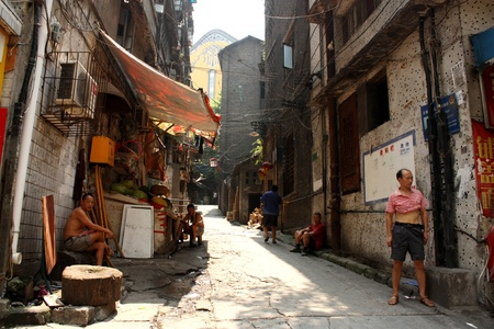 dirty old man: Poverty in streets of China, Chongqing, China - July 27, 2010