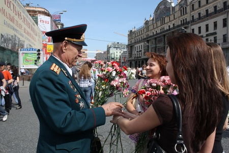 Celebration of Victory Day in Moscow - Young girls congratulate the Veteran of War - 9th of May 2010