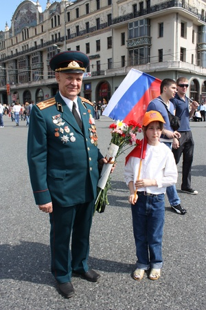 Celebration of Victory Day in Moscow - Little girl congratulate the Veteran of War - 9th of May 2010