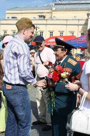 Celebration of Victory Day in Moscow - Young man congratulates the Veteran of Second World War - 9th of May 2010