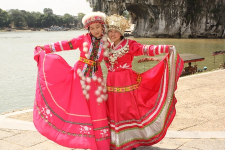 Nice chinese girls in beautiful red traditional dresses, Guiling, China - August 3, 2010