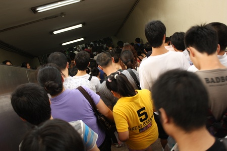 congestion: Crowd in a rush-hour in Beijings subway, China - July 17, 2010