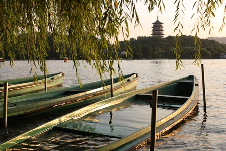 Boats on the West lake at sunset and Pagoda, Hangzhou, China