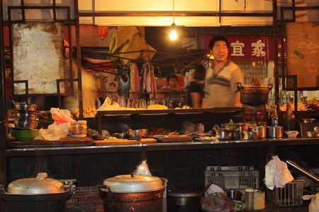 Street kitchen in Luoyang in China - July 21, 2010
